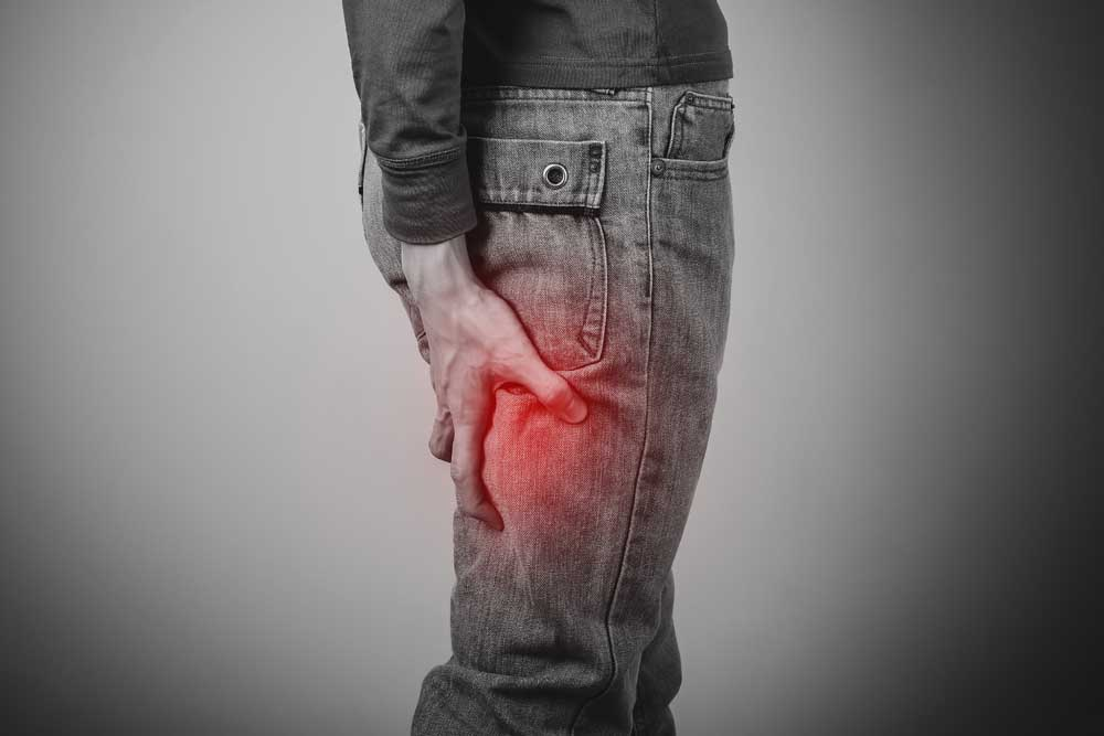 man suffering from sciatica pain